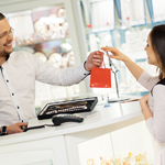 Man cashing out at counter